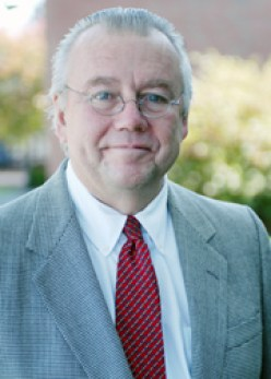 This formal image is taken of Professor Sullivan in a garden.