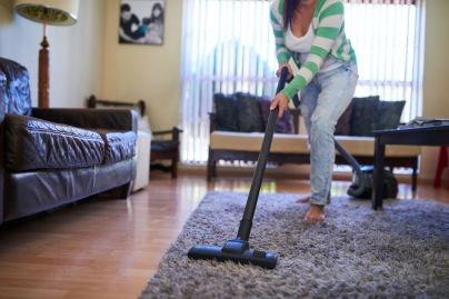 A woman cleaning her room