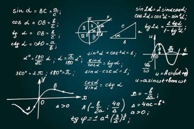 Mathematical equations written on a blackboard
