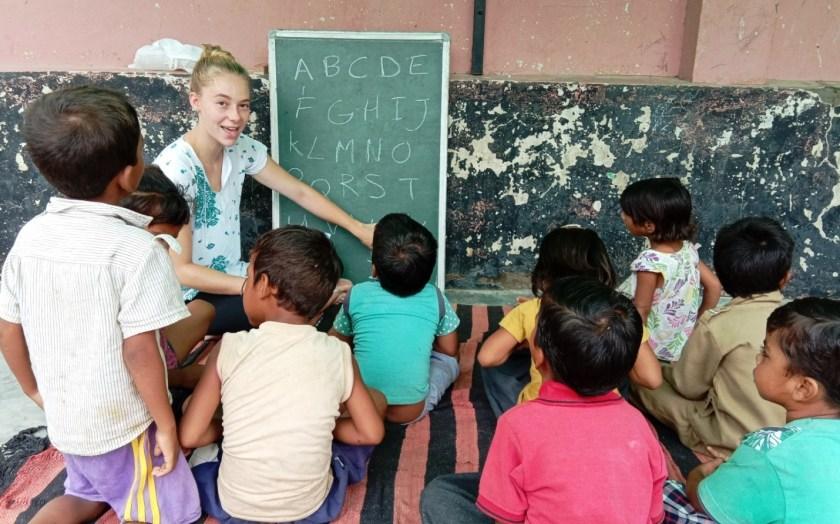 Volunteer student teaching street children