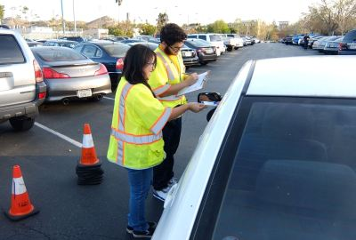 The University of Toronto Scarborough Staffs checking vehicles parking tickets