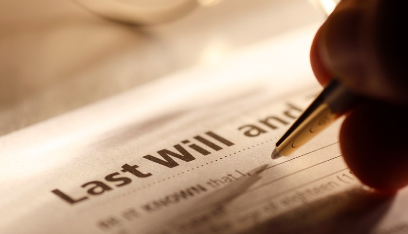 a person filling out a will
