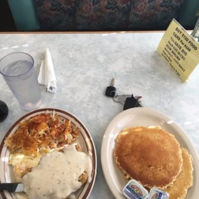 a stack of pancakes and potatoes