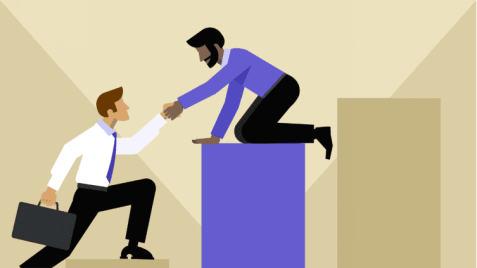 A man sitting above helping a man to come up