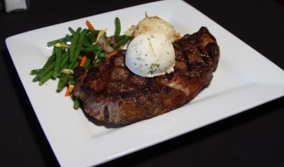 beef steak with veggies serving in a plate