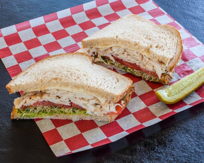 a turkey sandwich with pickle