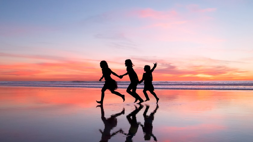 Silhouette photo of children running in the beach