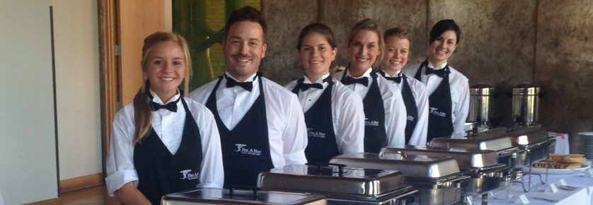 Wait staff pose for a picture
