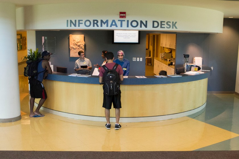 Students at information desk of University of Michigan-Dearborn