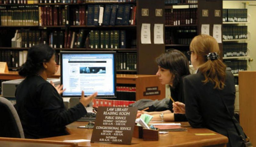 Library assistants help visitors get necessary information