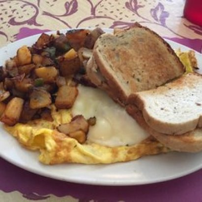 eggs with potatoes and a sandwich