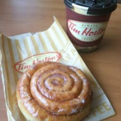 cup of coffee and cinnamon roll