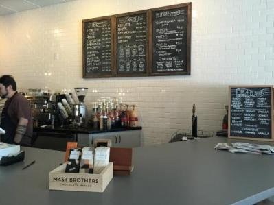 the front of the store with chalk board