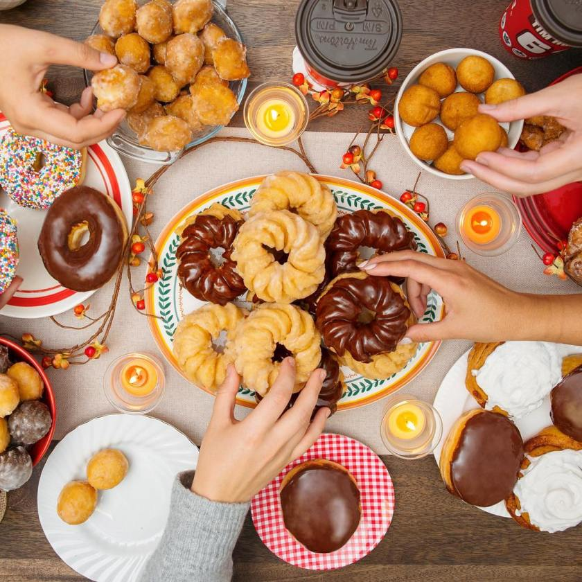 a bunch of people enjoying donuts and timbits from Tims Horton.