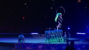 Acrobat jumping  through a hoop 10 feet up