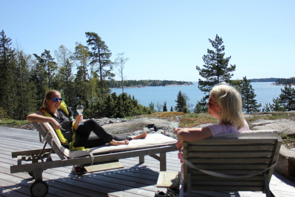 Beautiful Finnish summer cottage and two happy guests.