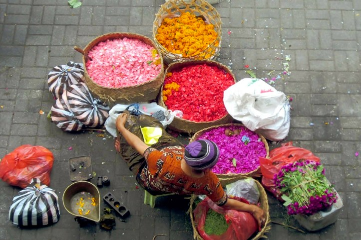 Woman selling flower petals at Ubud Market, Bali