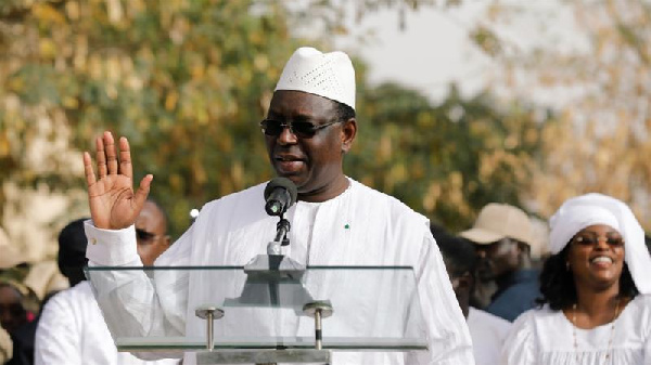 Senegal's President Macky Sall speaks after casting his vote at a polling station in Fatick, Senegal
