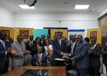 Officials of GN Savings and Ecobank Ghana in a group photograph after signing the agreement