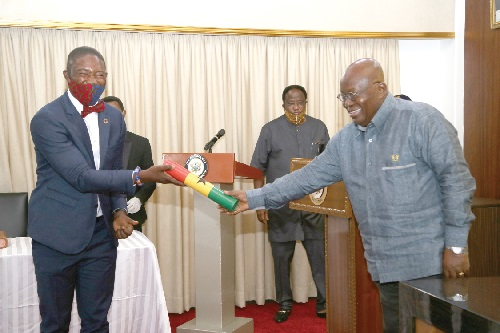 President Nana Addo Dankwa Akufo-Addo presenting the instrument of Office to Dr Bernard Okoe Boye (left), the new Deputy Minister of Health. Picture SAMUEL TEI ADANO
