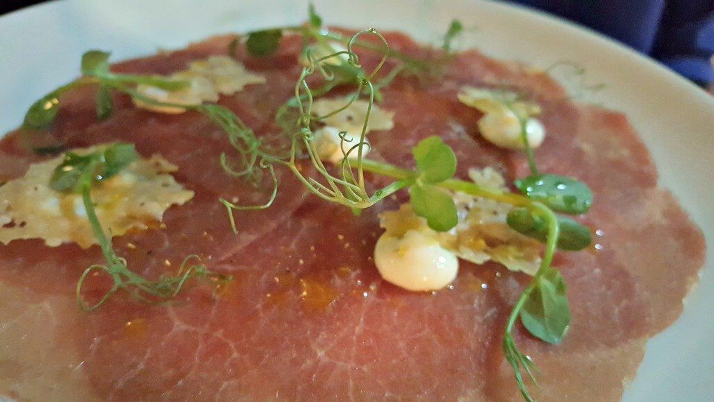sampling the new menu at browns brasserie & bar beef carpaccio with pea shoots and Parmesan crisps
