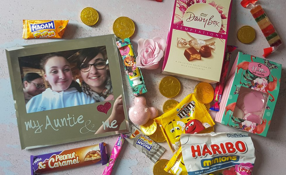 flatlay of mirror photo frame surrounded by sweets