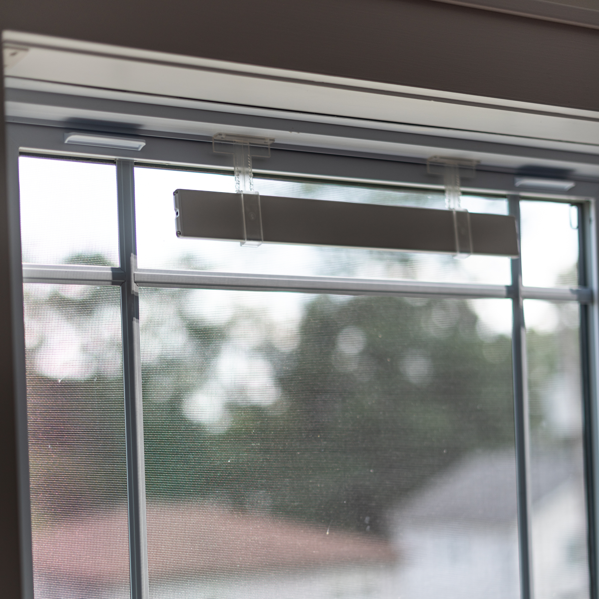 Solar Panel mounted on top of the window with sticky double-sided tape