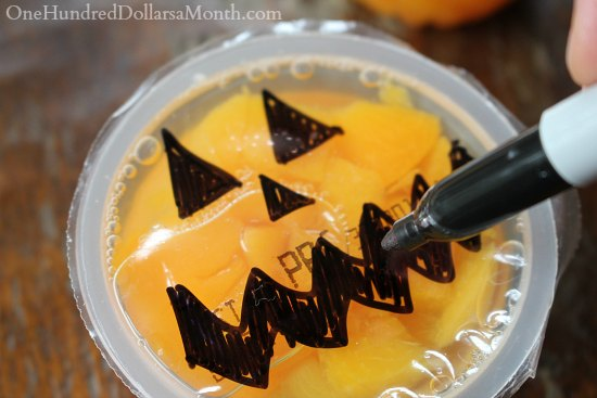 Halloween Lunch Snacks - Peach Pumpkin Faces