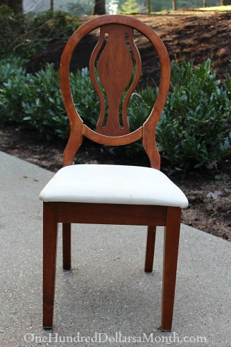 old chair with seat cushion