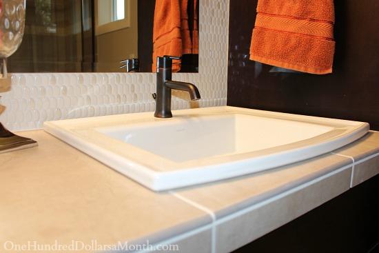 Elegant Or trendy penny tile bathroom vanity