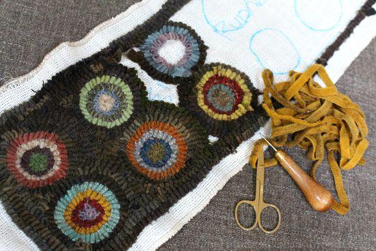Primitive hooked penny rug