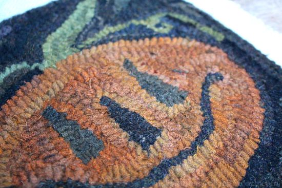 primitive hooked pumpkin rug