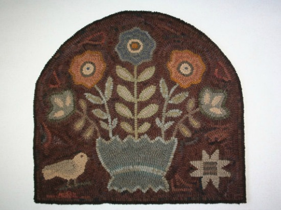 primtive hooked rug flowers