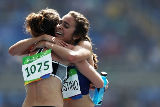 hugging olympic runners