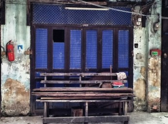 blue doors and a woodle bench