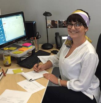 Photo of Lea Volk at her desk