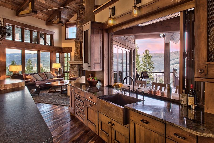 Rustic ranch house in colorado opens to the mountains for Colorado style homes