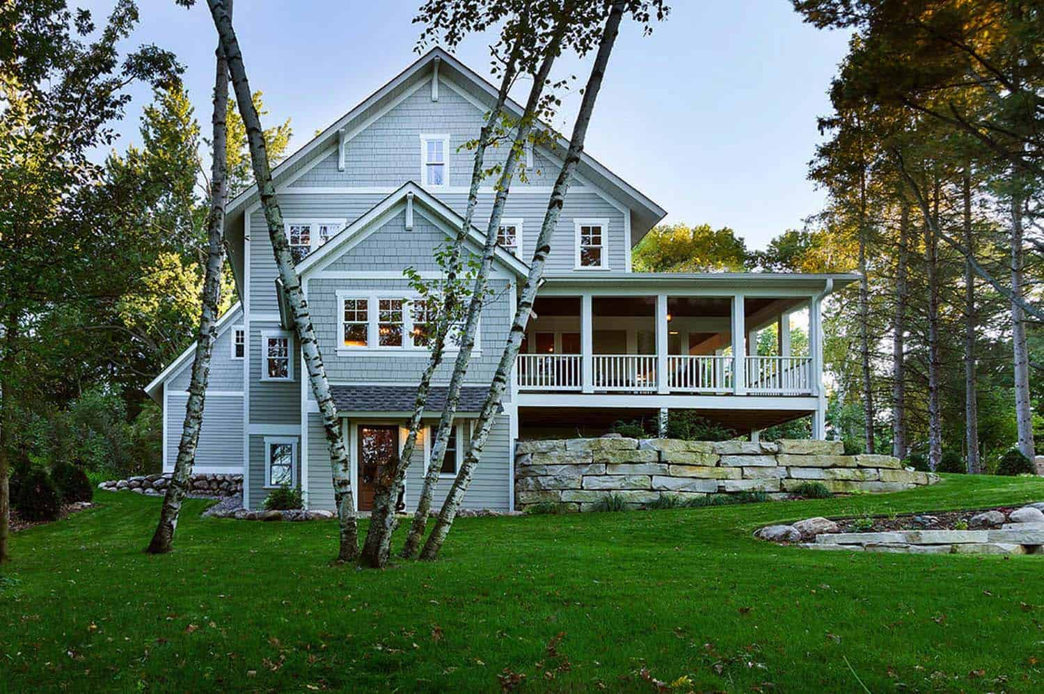 charming lakeside farmhouse nestled on a wooded site in minnesota