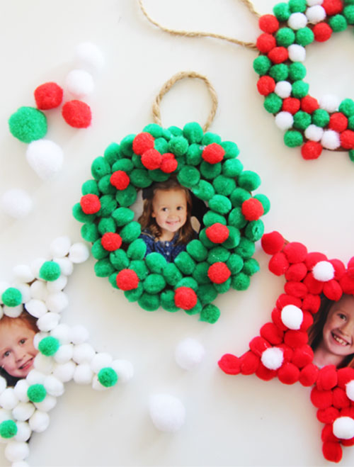 These pom pom Christmas photo ornaments are SO EASY for kids to make and would make the perfect addition to any tree this holiday!
