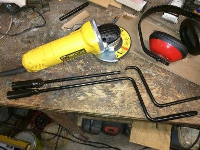 I cut the handle off of a second crank using a grinding wheel. I carry both, so I can still operate the jack without power.