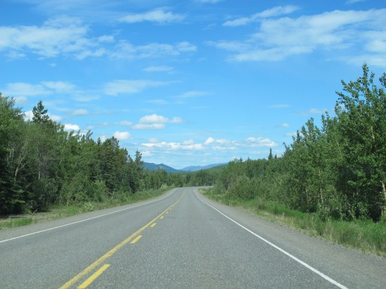 Klondike Highway, fairly typical two lane chip seal with soft gravel shoulders.