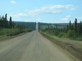 Back on the road, notice how it just goes straight up over the hill. That's the haul road ethic. Straight as you can.