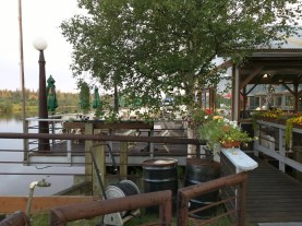The saloon area and deck overlooking the Chena river.