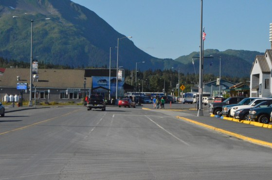 Walking along the waterfront in Seward heading for the docks.