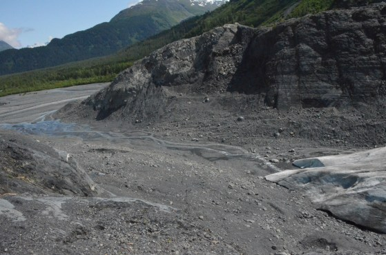 The toe of the glacier. In 2007 the glacier would have filled this area and extended a bit onto the plain below.