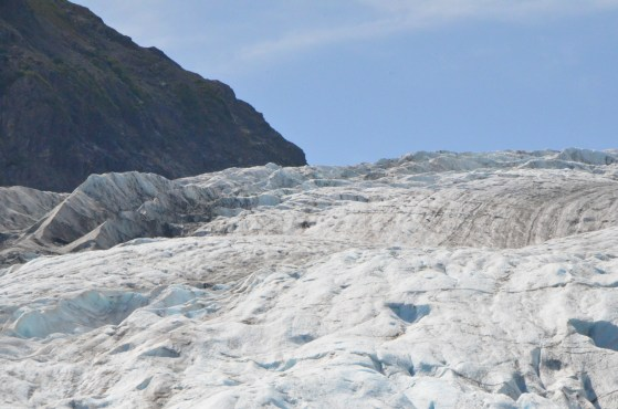 As the ice flows up against a ridge of rock it breaks along the flow and forms longitudinal ridges