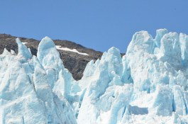 Looking over the end of the Glacier at the mountain behind