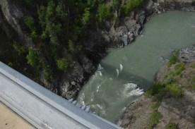 The bridge's shadow on the water below