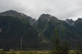 In the town of Stewart hills on either side have glaciers on top.