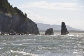 Rocks off a headland on the west side.